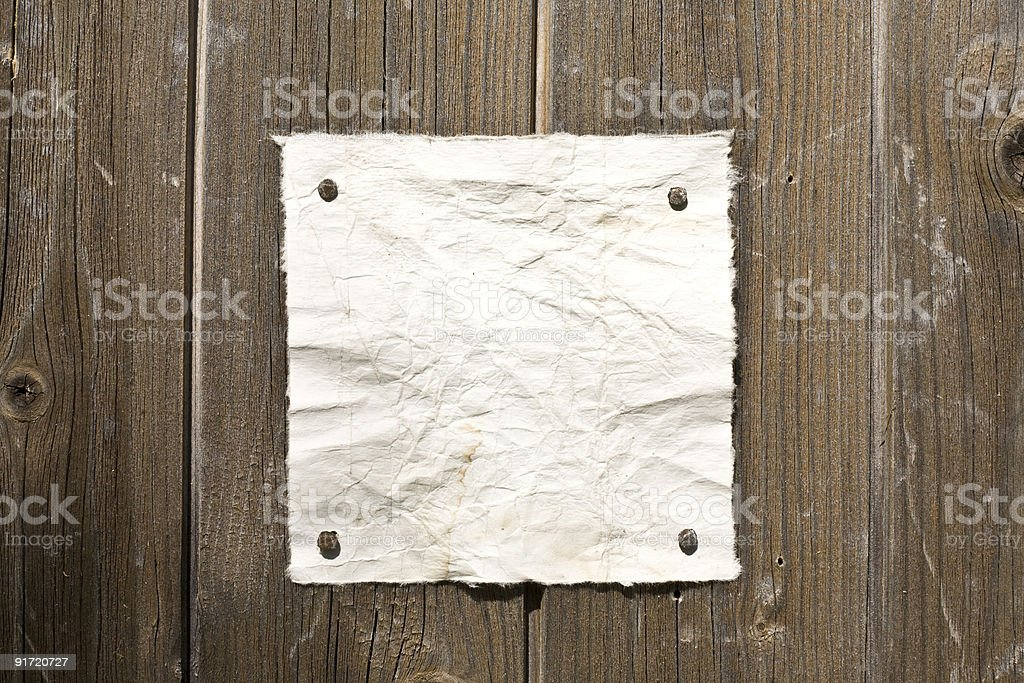 Retro Paper On Wooden Wall royalty-free stock photo