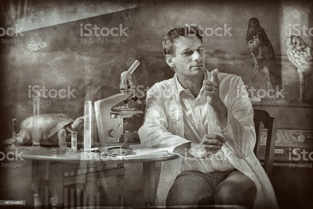 Retro photo of classical old scientist researching in laboratory stock photo