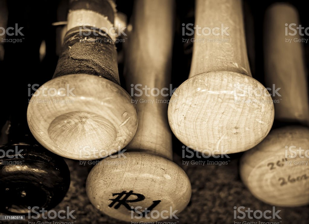 Retro photo of old baseball bats inscribed stock photo