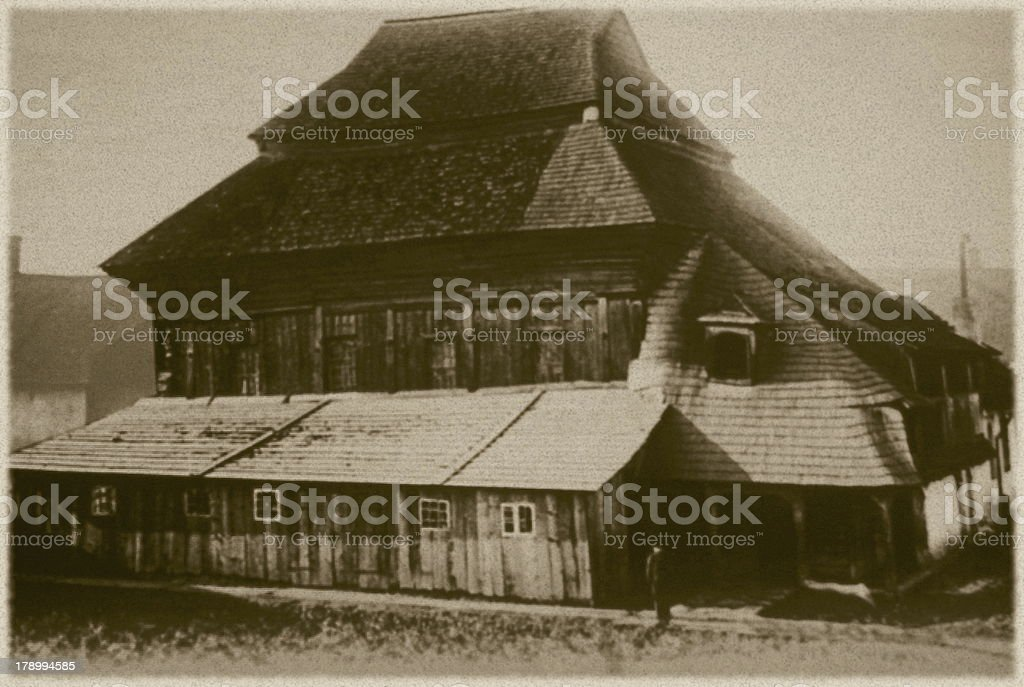 Retro photo of  old wooden synagogue  in Chodorow, Ukraine stock photo