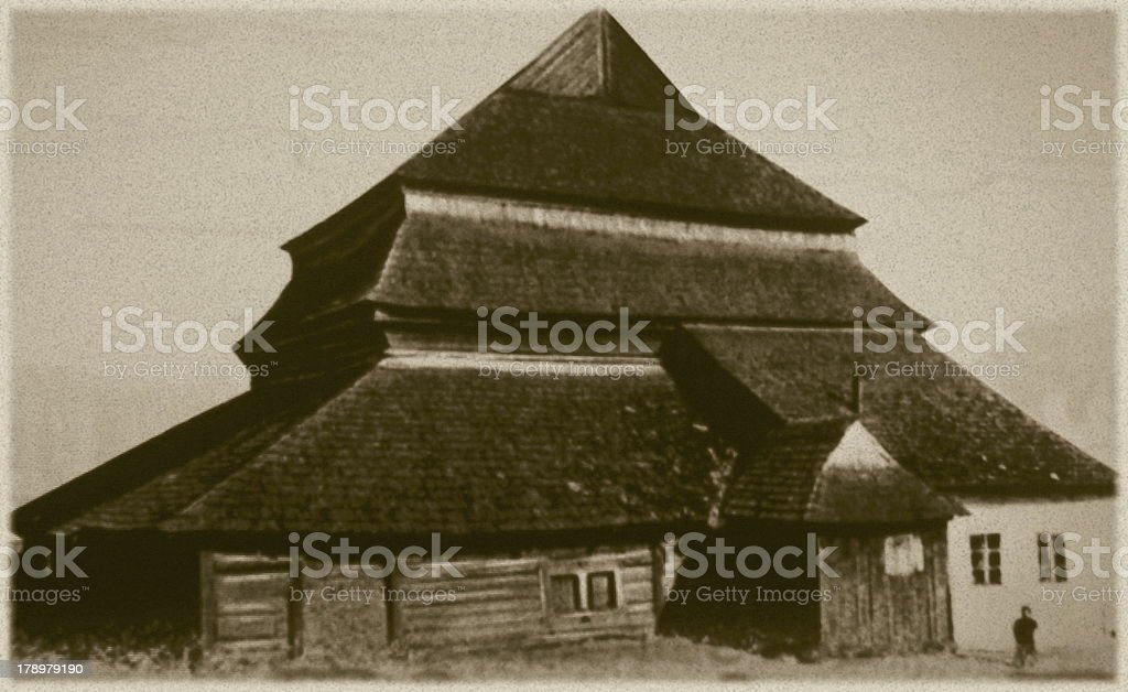 Retro photo of  old wooden synagogue  in Gwozdiec,  Western Ukraine, stock photo