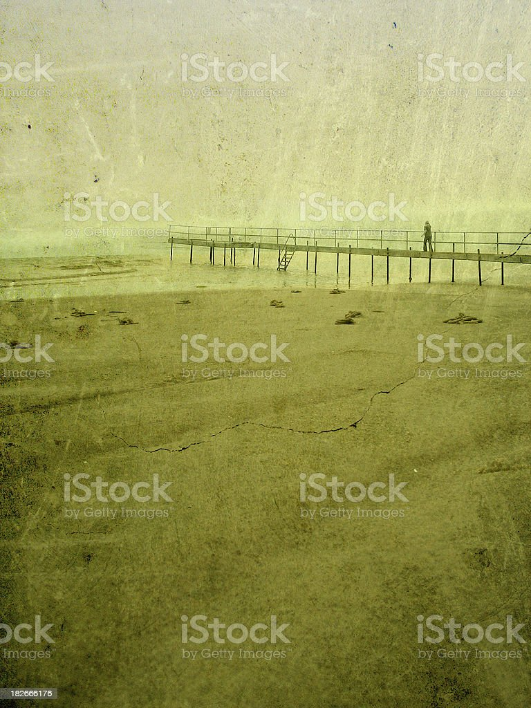 Retro photograph of woman walking alone on pier royalty-free stock photo