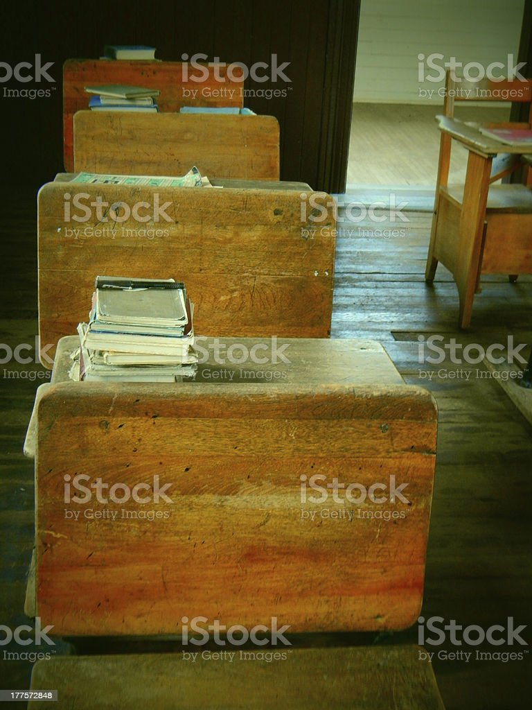 Retro picture of classroon desks and student books royalty-free stock photo