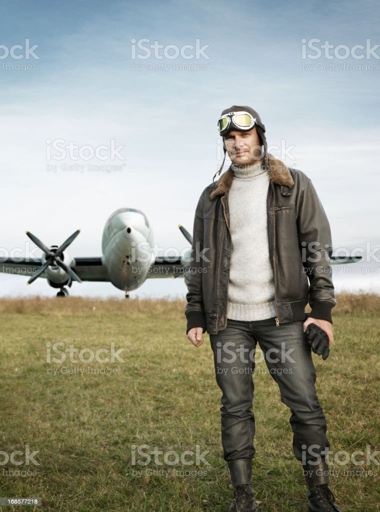 Retro pilot and his airplane stock photo