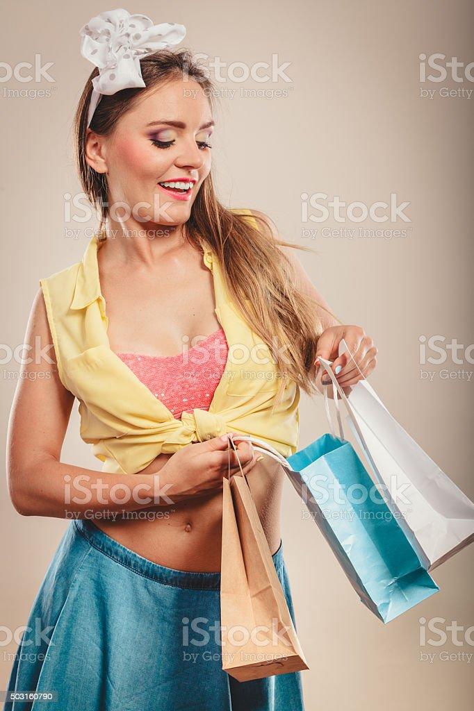 Retro pin up girl shopping stock photo