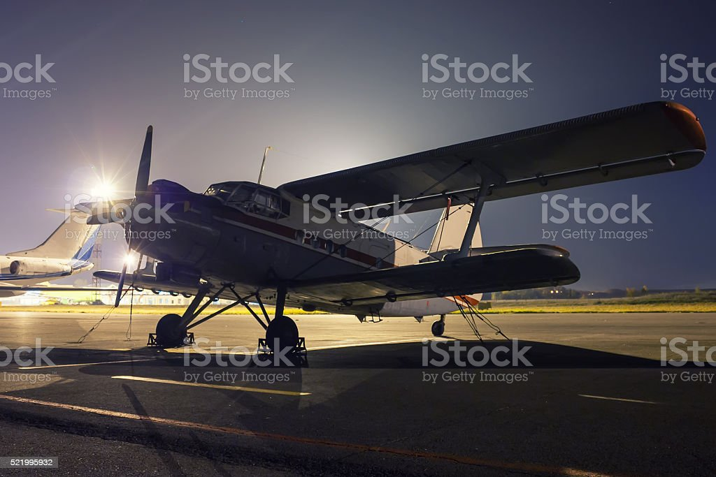 Retro plane on the summer night at the airport royalty-free stock photo