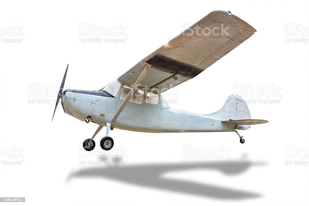 Retro plane struck the ground white. stock photo