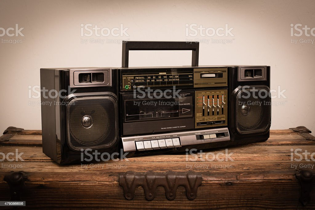 Retro Portable Boom Box Stereo from 1980s on Old Trunk stock photo