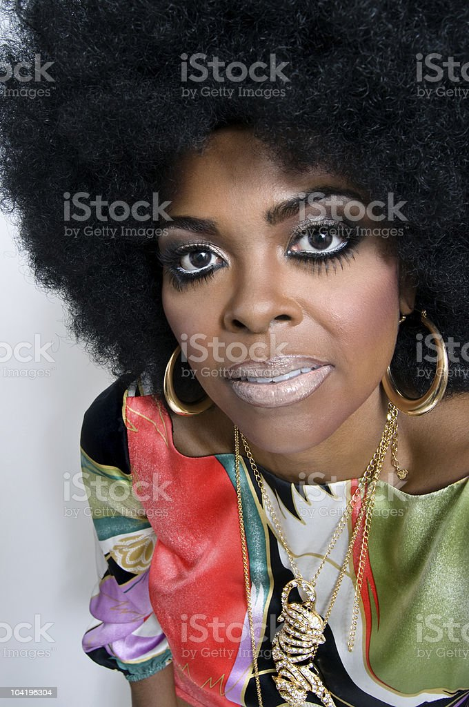 Retro portrait of a foxy lady in 1970's hair and attire stock photo