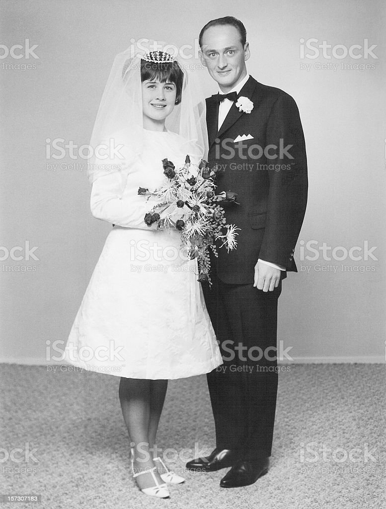 Retro portrait of a just married couple at the wedding stock photo