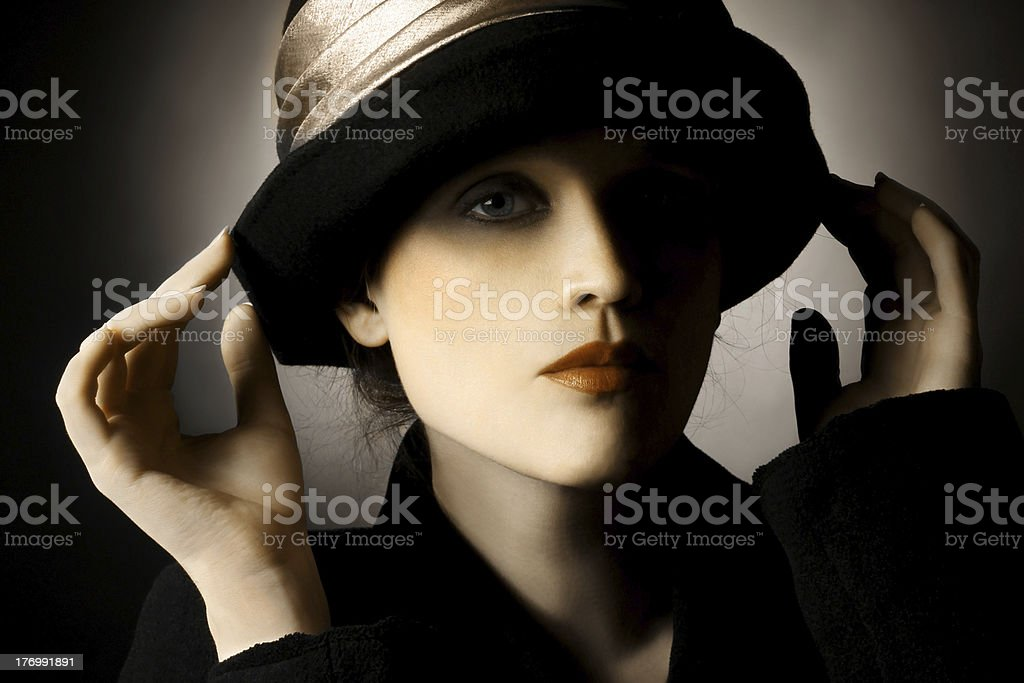 Retro portrait of woman in hat stock photo