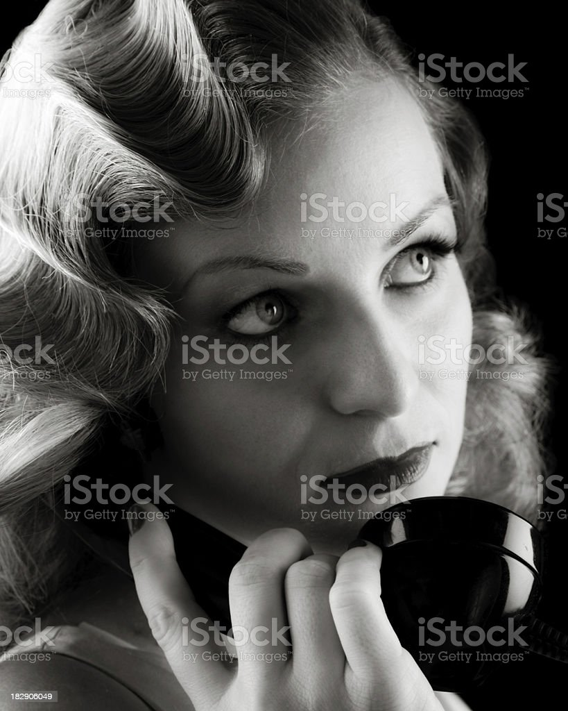 Retro Portrait of Woman on Old Telephone. Film-noir B&W. royalty-free stock photo