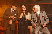 Retro pub  Old-fashioned senior men and young woman Best friends