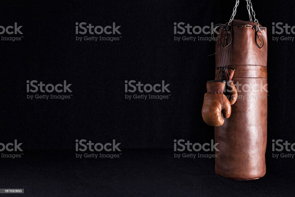 Retro Punching Bag and Boxing Gloves stock photo