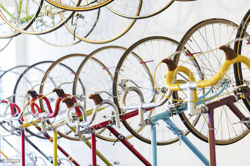 Retro Racing Bicycles Hanging In Bike Shop stock photo