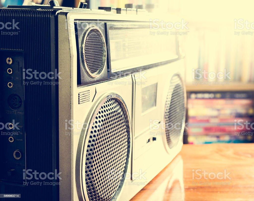 Retro radio cassette stereo recorder on wooden desk stock photo
