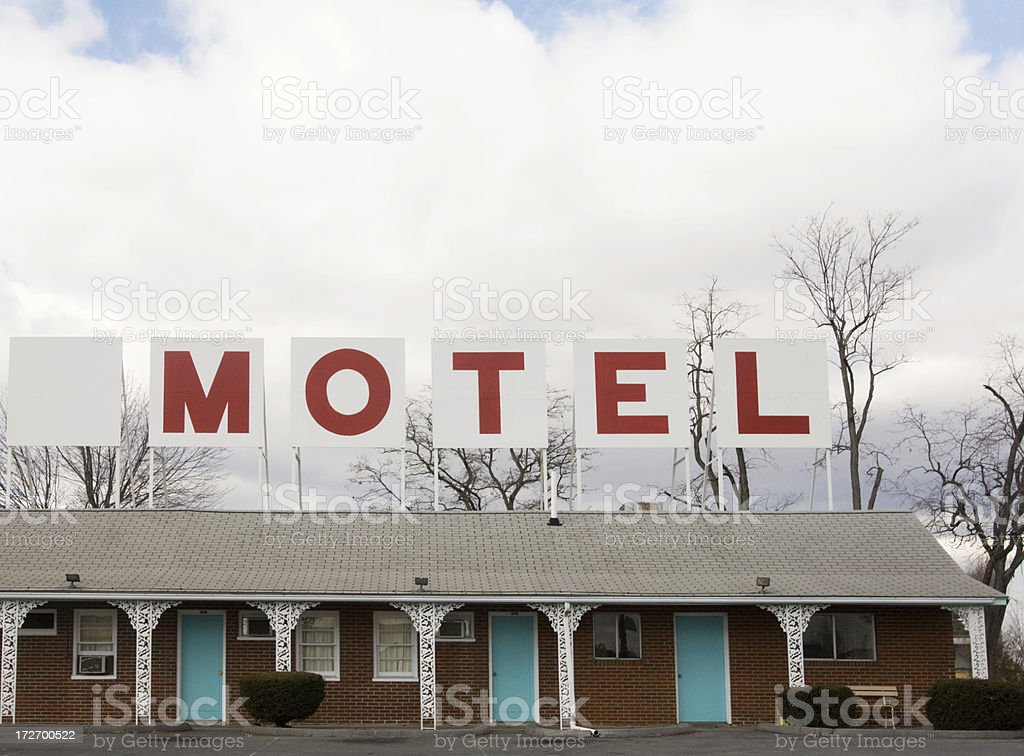 Retro Red Lettered Motel Sign on top of building stock photo