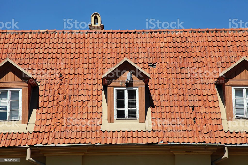Retro red tile roof of old house stock photo