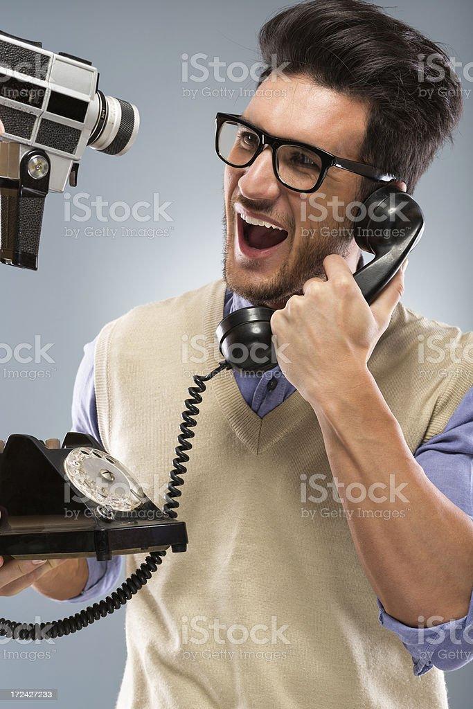 Retro revival nerd on the phone stock photo