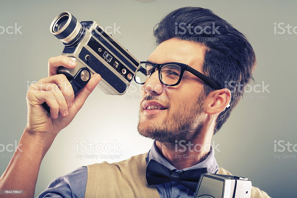 Retro revival nerd with old fashion camera stock photo