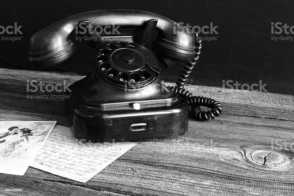 Retro rotary phone on a table royalty-free stock photo