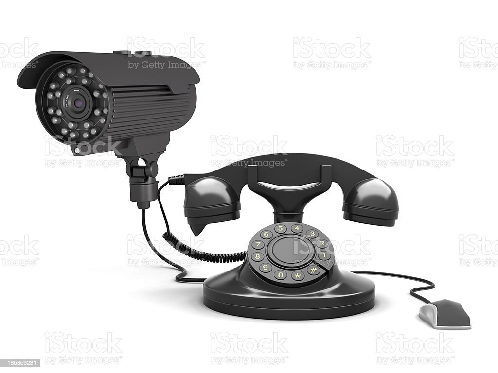 Retro rotary phone, security camera and computer mouse royalty-free stock photo