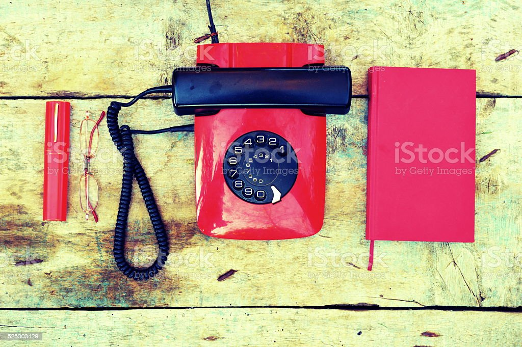Retro rotary telephone on a wooden background stock photo