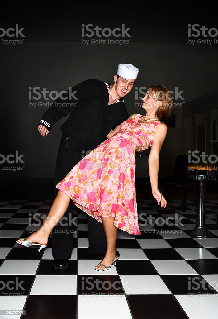 Retro Sailor and Woman Dancing stock photo