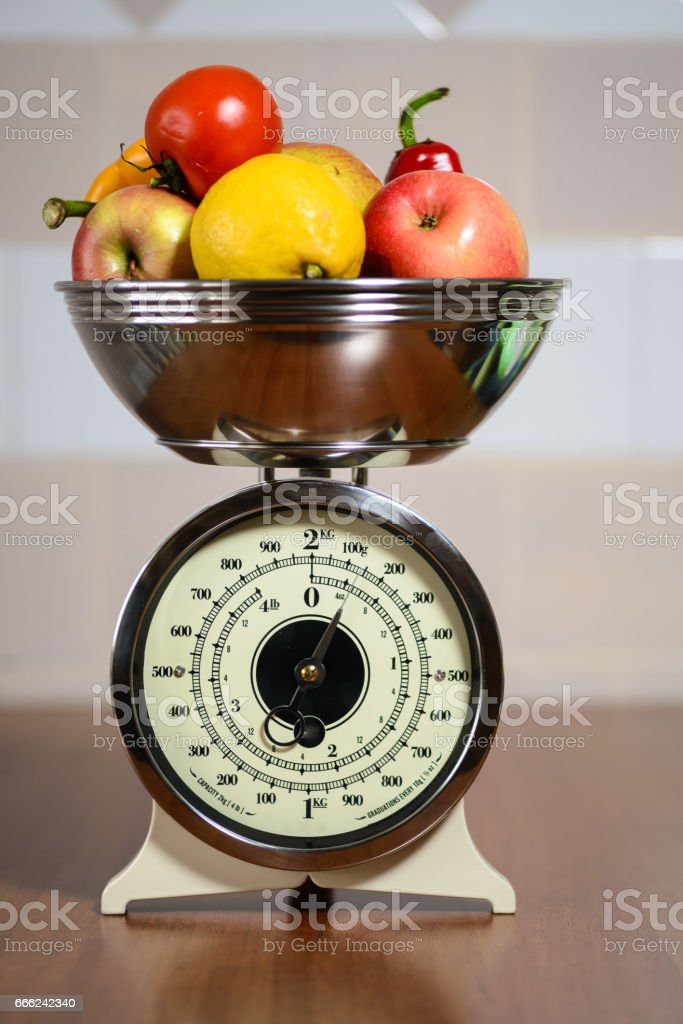 Retro scale with fruits and vegetables stock photo