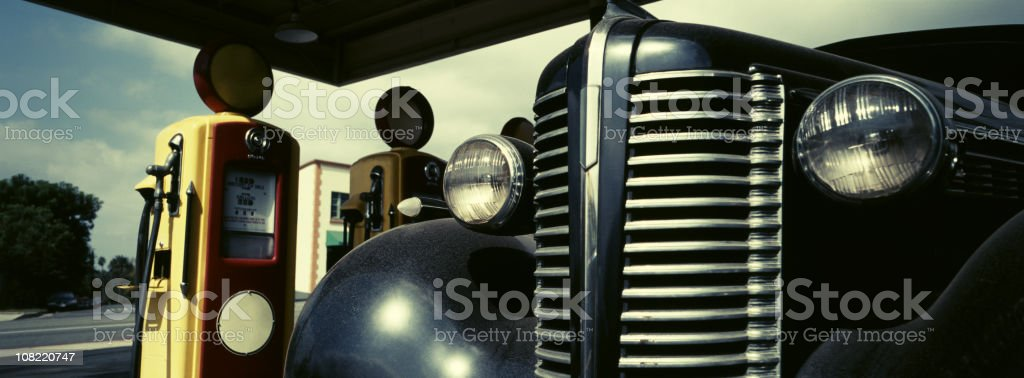 Retro Scene with Vintage Gas Pumps and Car stock photo