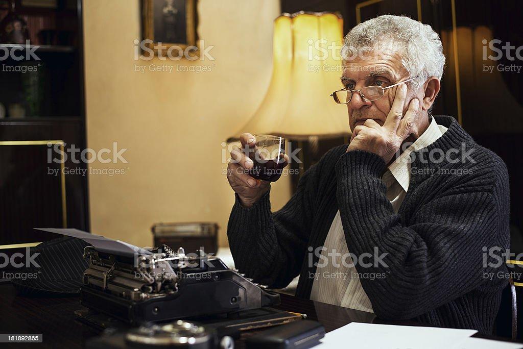 Retro Senior Man writer with a glass of whiskey royalty-free stock photo