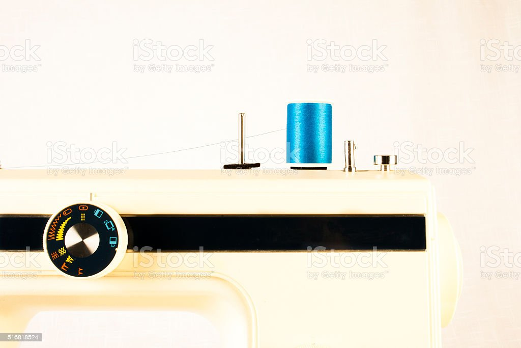 Retro Sewing Machine with Blue Thread Closeup stock photo