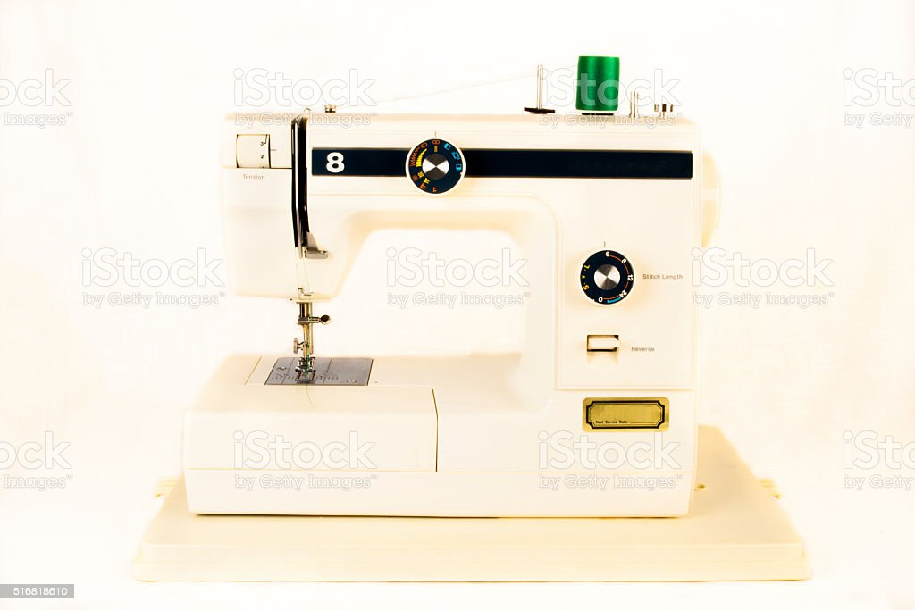 Retro Sewing Machine with Green Thread stock photo