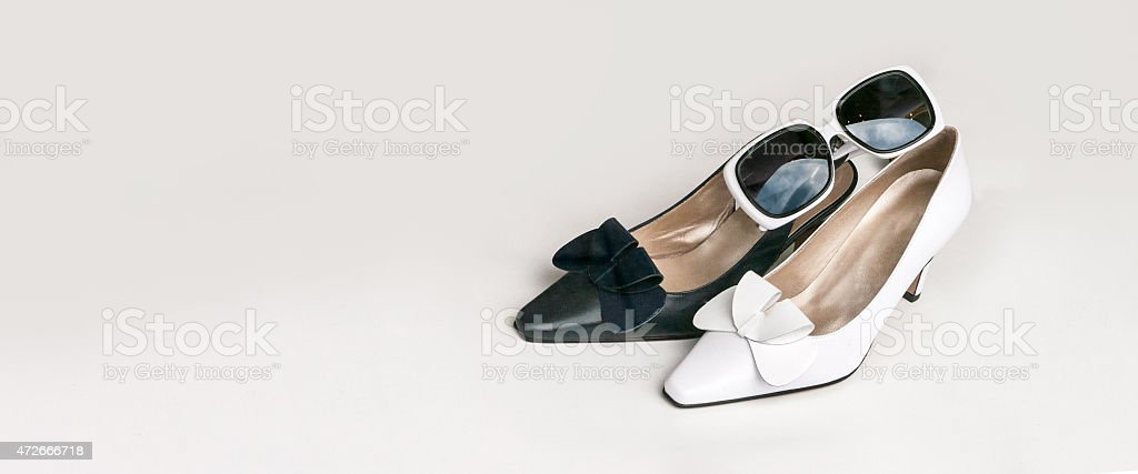 Retro sixties black and white pump, slingback and b sunglasses stock photo