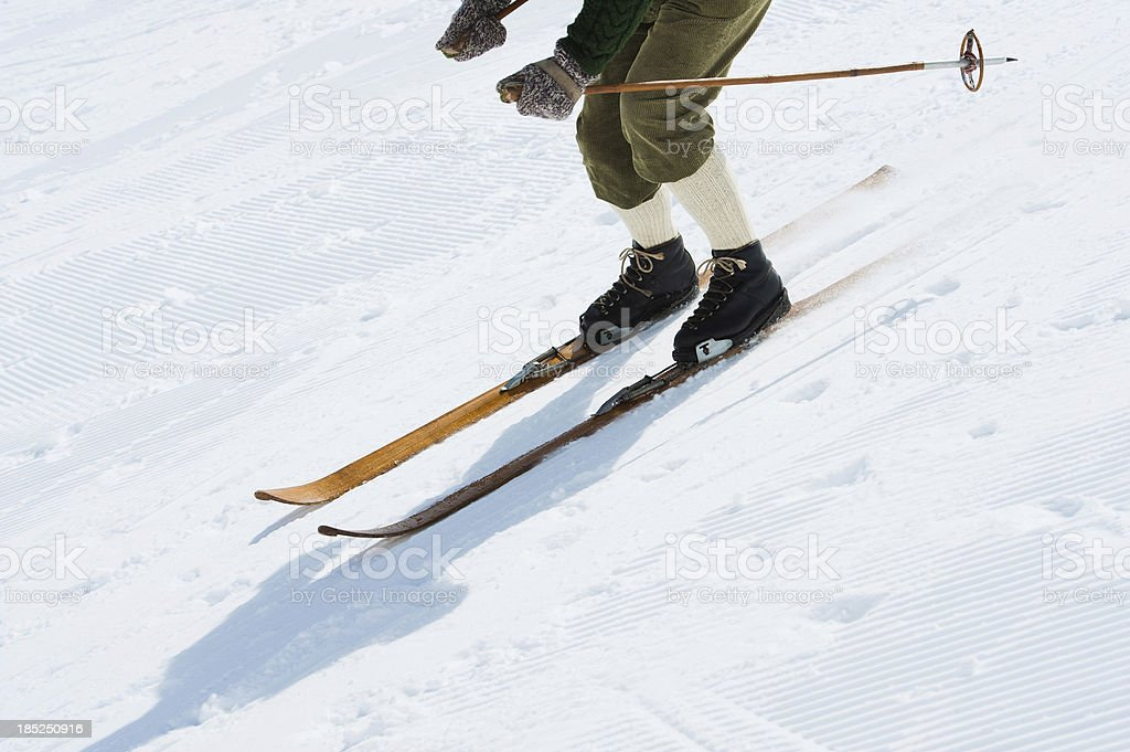 \'Side view of male adult retro skier in the action, ski equipment...
