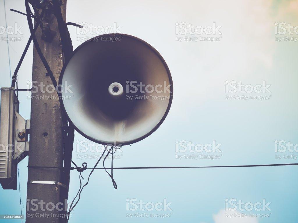 Retro speaker on blue sky stock photo