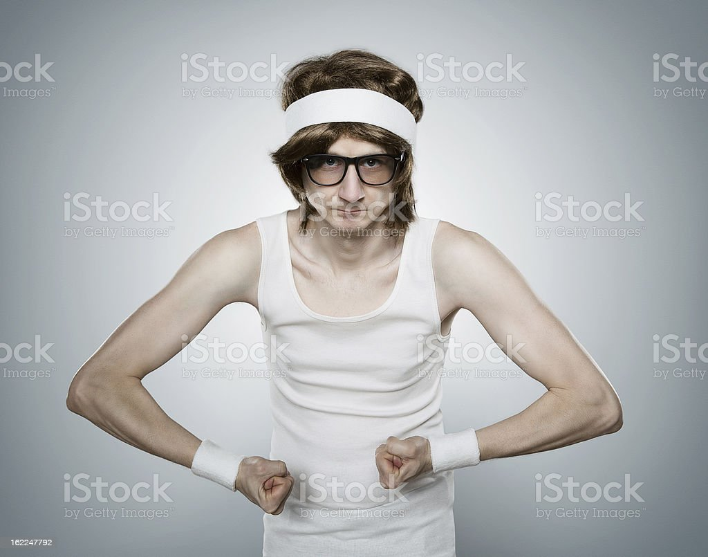 A retro sports nerd trying to look muscular stock photo