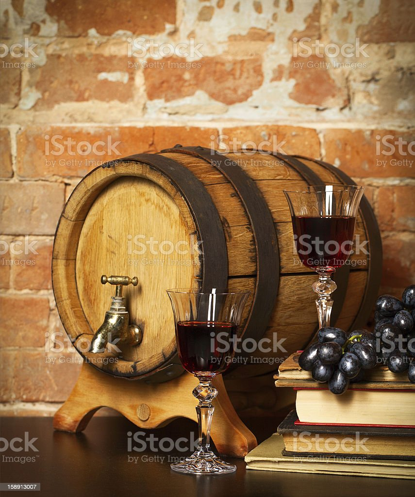 Retro still life with red wine and barrel royalty-free stock photo