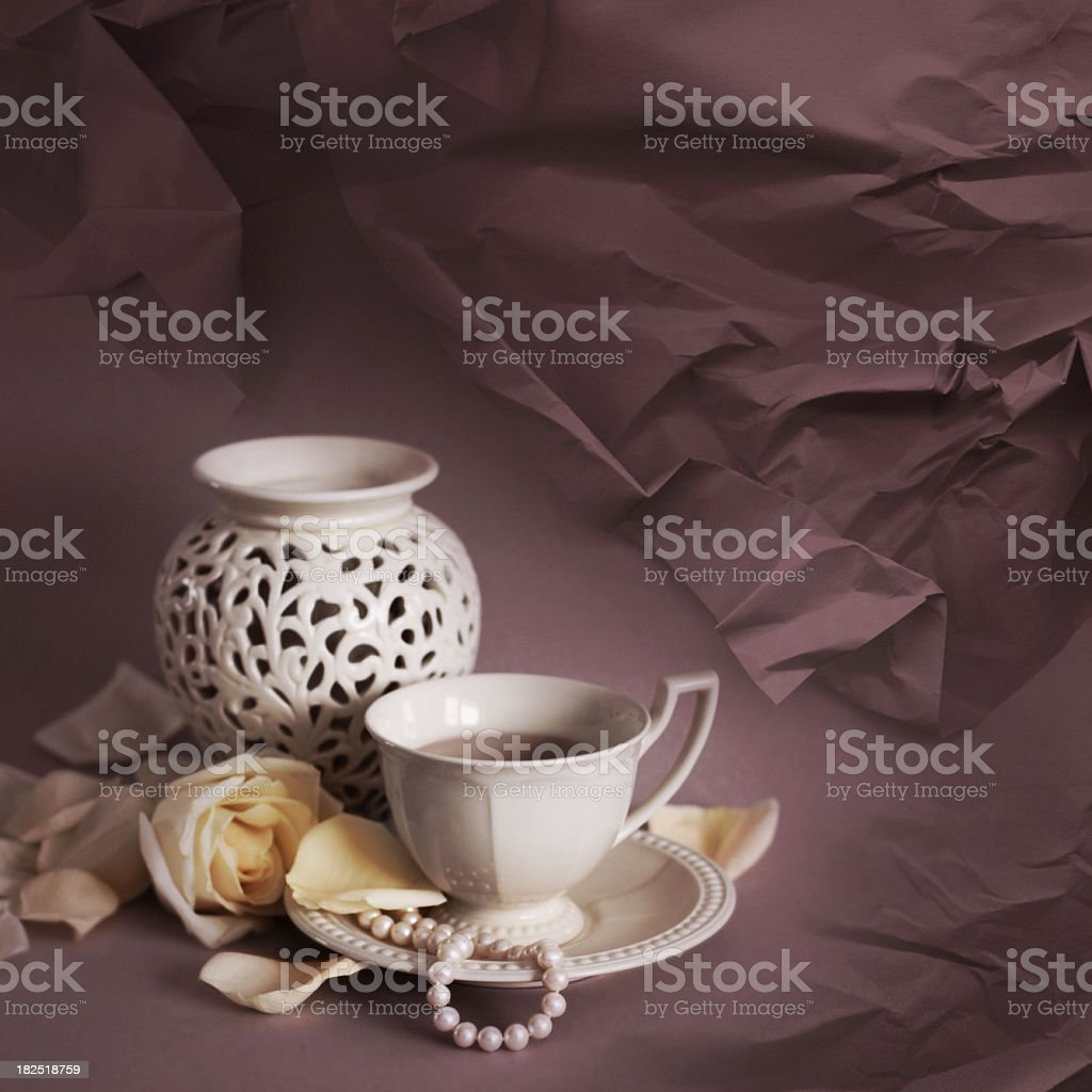Retro stillife with cup, vase and tea rose royalty-free stock photo