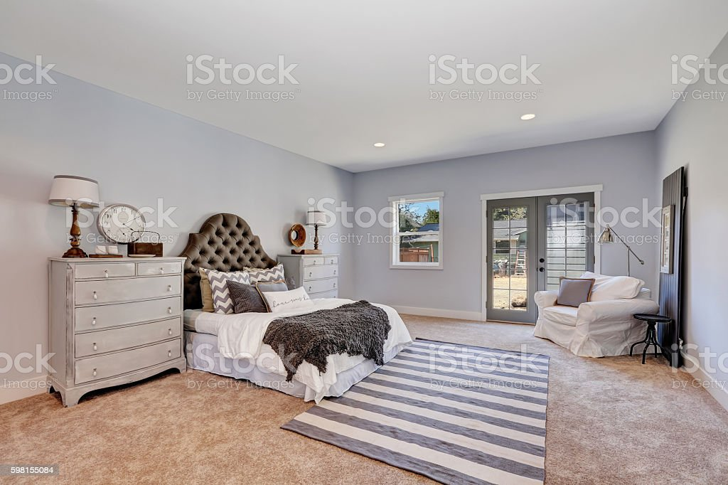 Retro style bedroom in pastel tones with vintage furniture stock photo