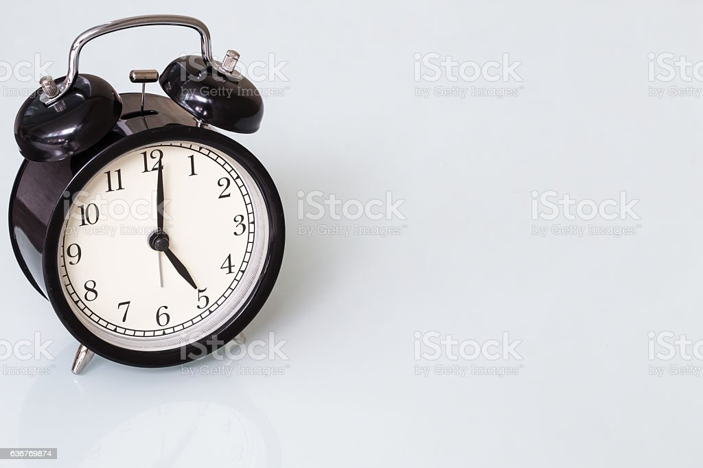 retro style black bell clock time at 5 o'clock stock photo