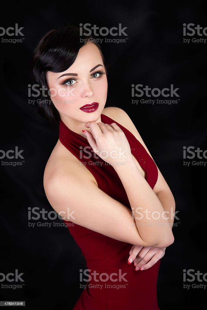 Retro style brunette woman touching her face stock photo