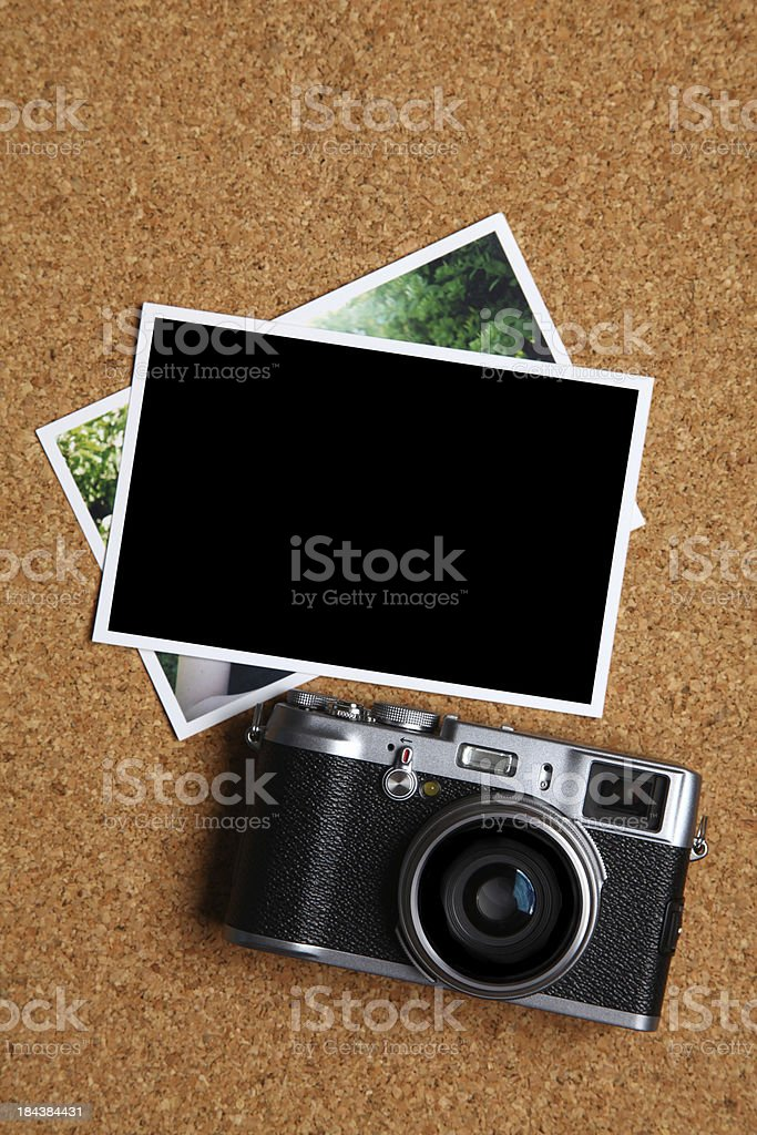 Retro style camera with blank photographs royalty-free stock photo
