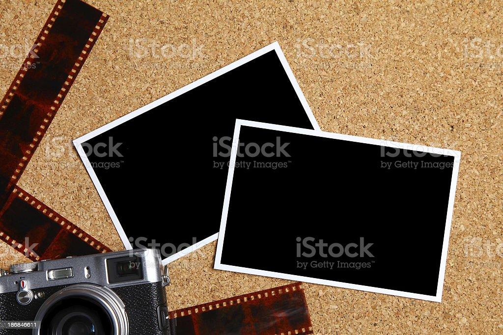 Retro style camera with blank photographs stock photo