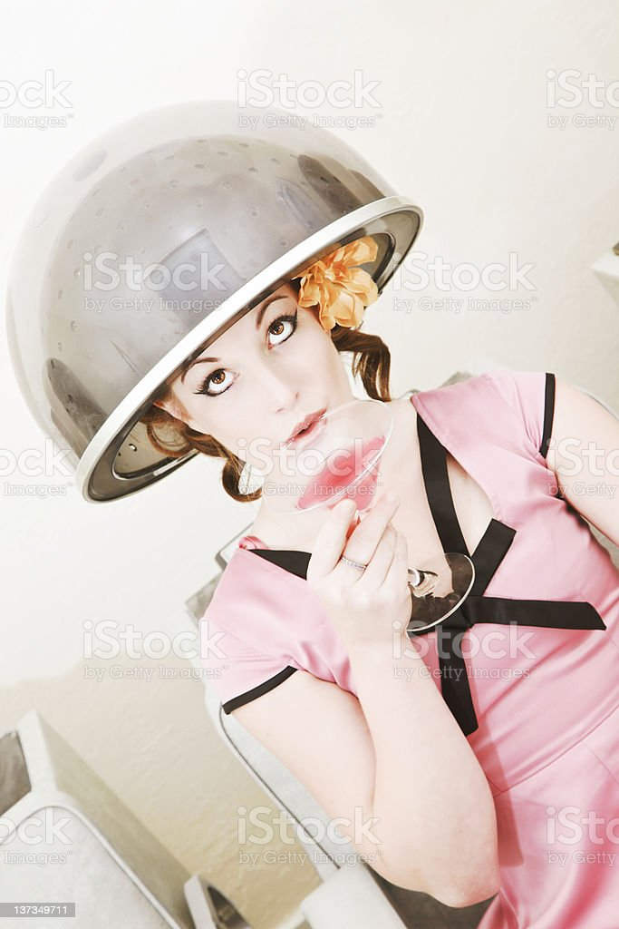 Retro Style Client Under Beauty Salon Hair Dryer With Martini royalty-free stock photo