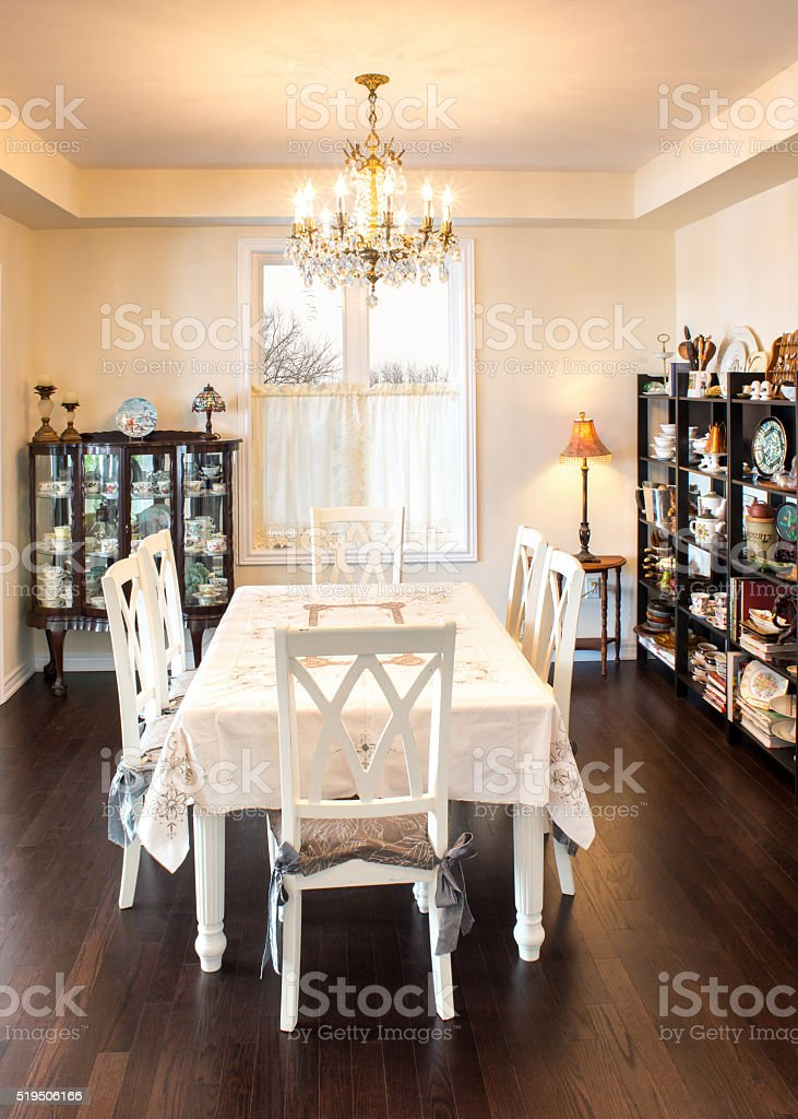 Retro style dining room in warm light stock photo