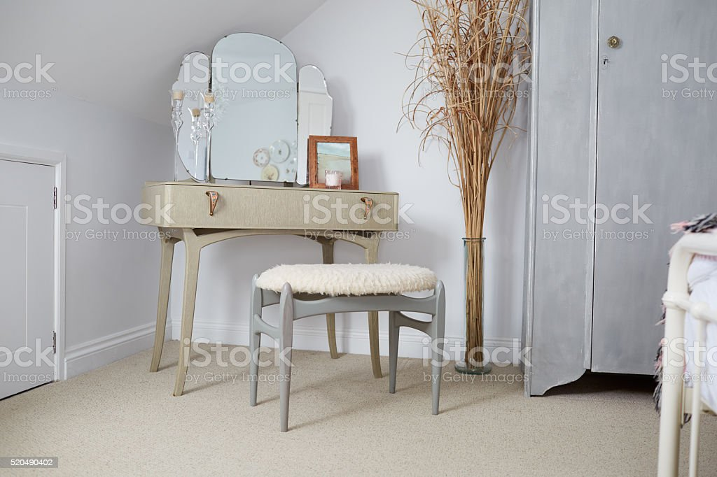 Retro Style Dressing Table In Stylish Apartment stock photo