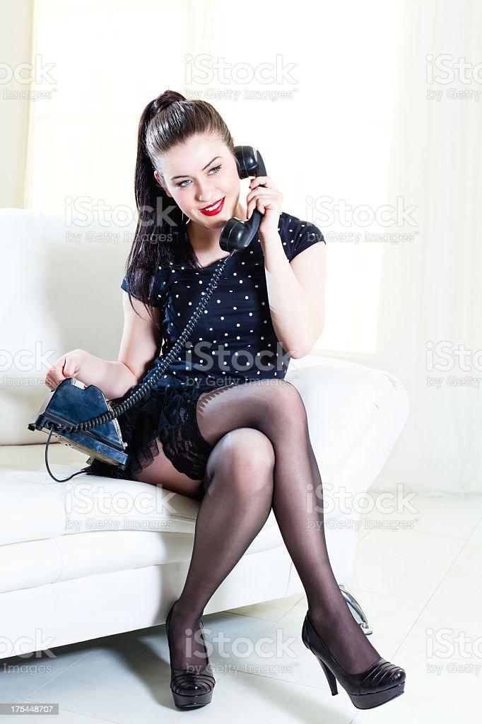 Retro style girl talking on the phone stock photo