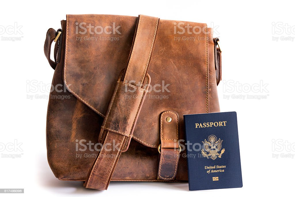 Retro Style Leather Bag with Biometric American Passport stock photo