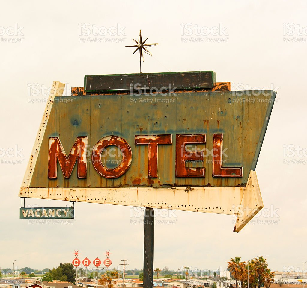 Retro style motel sign with arrow stock photo